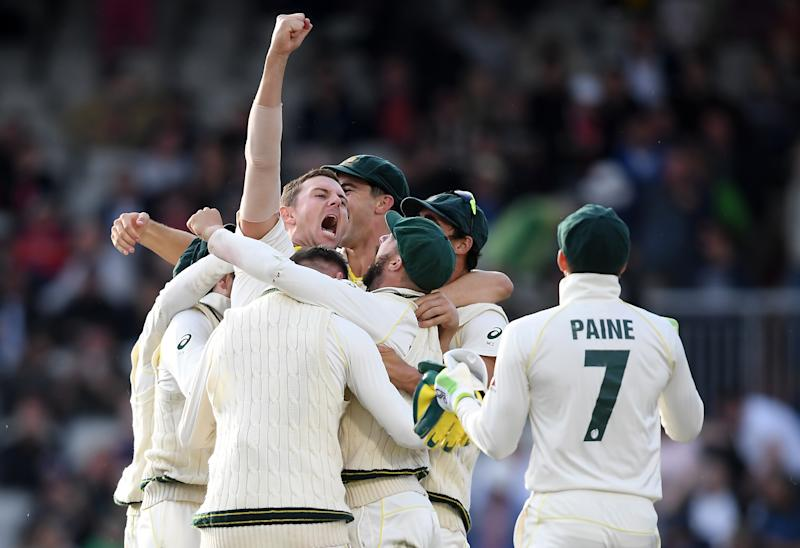 MANCHESTER, ENGLAND - SEPTEMBER 08: Josh Hazlewood and Australia celebrate taking the final wicket of Craig Overton of England to win the Test Match and retain the Ashes during Day Five of the 4th Specsavers Ashes Test between England and Australia at Old Trafford on September 08, 2019 in Manchester, England. (Photo by Alex Davidson/Getty Images)