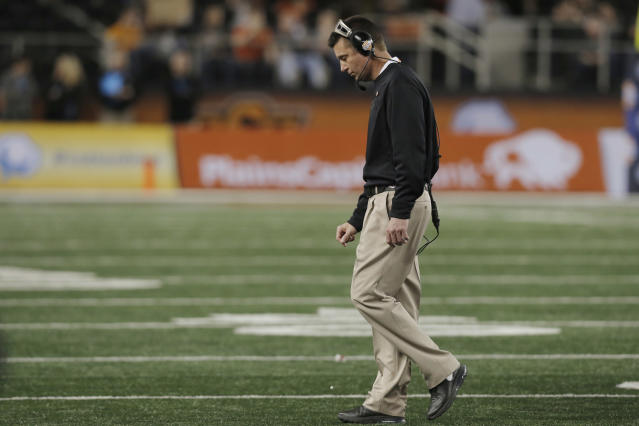 Oklahoma State head coach Mike Gundy leaves the field after a break against Missouri during the second half of the Cotton Bowl NCAA college football game on Friday, Jan. 3, 2014, in Arlington, Texas. (AP Photo/Brandon Wade)