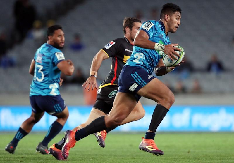 Top tryscorer: Auckland Blues' Rieko Ioane runs the ball against the Stormers last month (AFP Photo/MICHAEL BRADLEY)