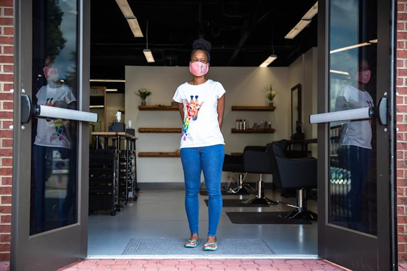 Nekita Sullivan, owner of Butterfly Eco Beauty Bar in Clemson, S.C., Aug. 14, 2020. Sullivan opened her salon in February before being forced to close down in March due to COVID-19.