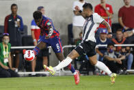 United States' Yunus Musah, left, kicks the ball past Costa Rica's Ronald Matarrita during the first half of a World Cup qualifying soccer match Wednesday, Oct. 13, 2021, in Columbus, Ohio. (AP Photo/Jay LaPrete)