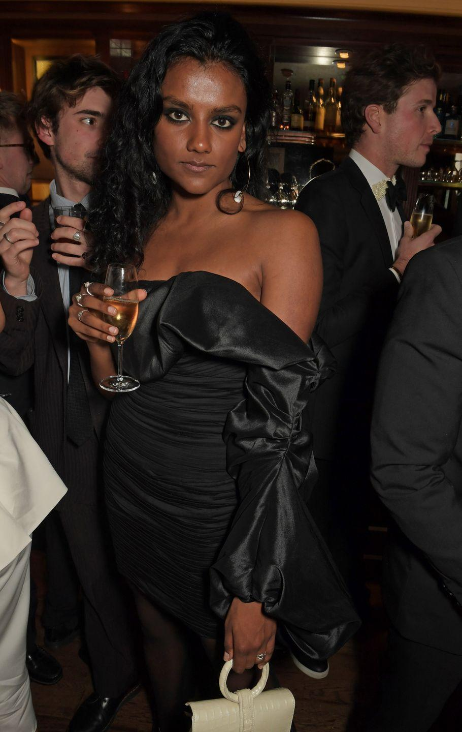 <p>The glamour! She styled out this incredible 80s-inspired off-the-shoulder LBD at a pre-BAFTA party in London last year.</p>