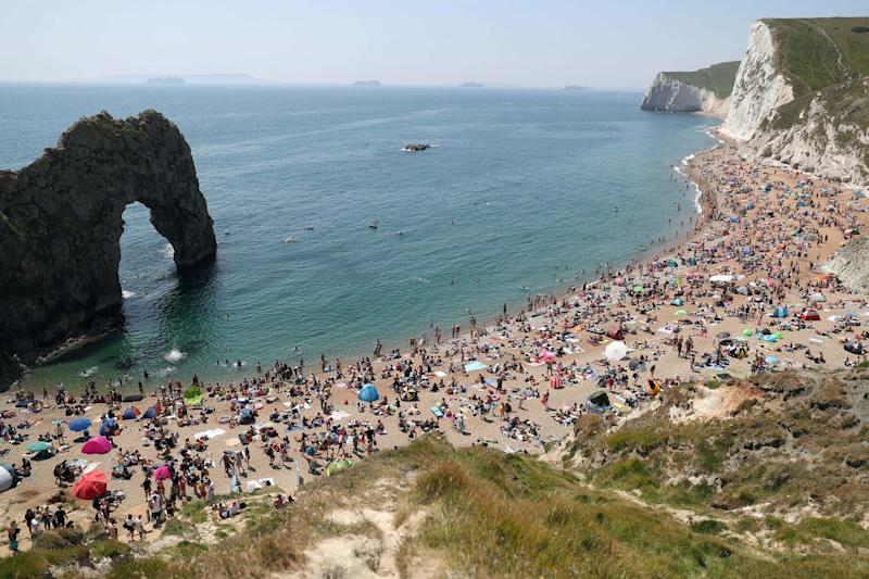 Durdle Door beach was packed out on Saturday (PA)