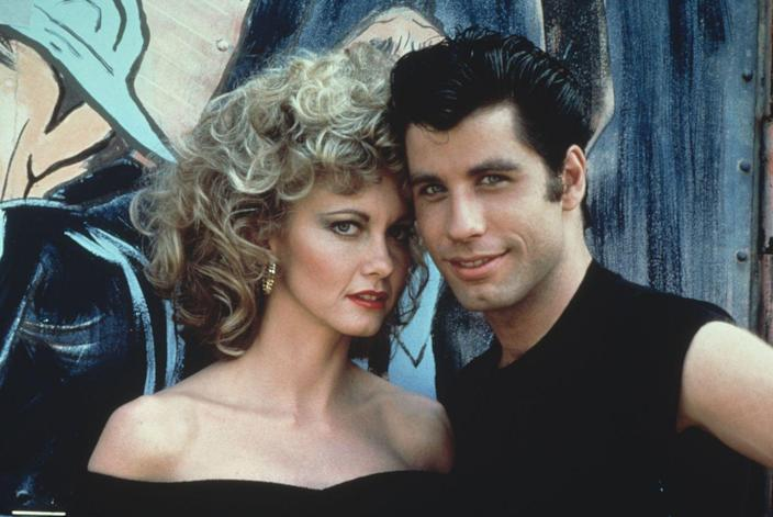 """<p>John Travolta and Olivia Newtown-John captured each other's hearts as Danny and Sandy, two high school students. The two met on the beach while Sandy was visiting from Australia, and she never expected to see him again. Sandy's parents decide to stay in the U.S. and Sandy became a part of The Pink Ladies, a clique of greaser girls. Sandy reunited with Danny, the leader of the T-Birds greaser gang, who was determined to keep up his bad boy reputation. The two reconciled on the last day of school and performed the memorable song, """"You're the One That I Want.""""</p>"""