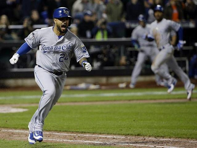 Christian Colón (pictured near) celebrates his go-ahead hit in Game 5 of the 2015 World Series. (AP)