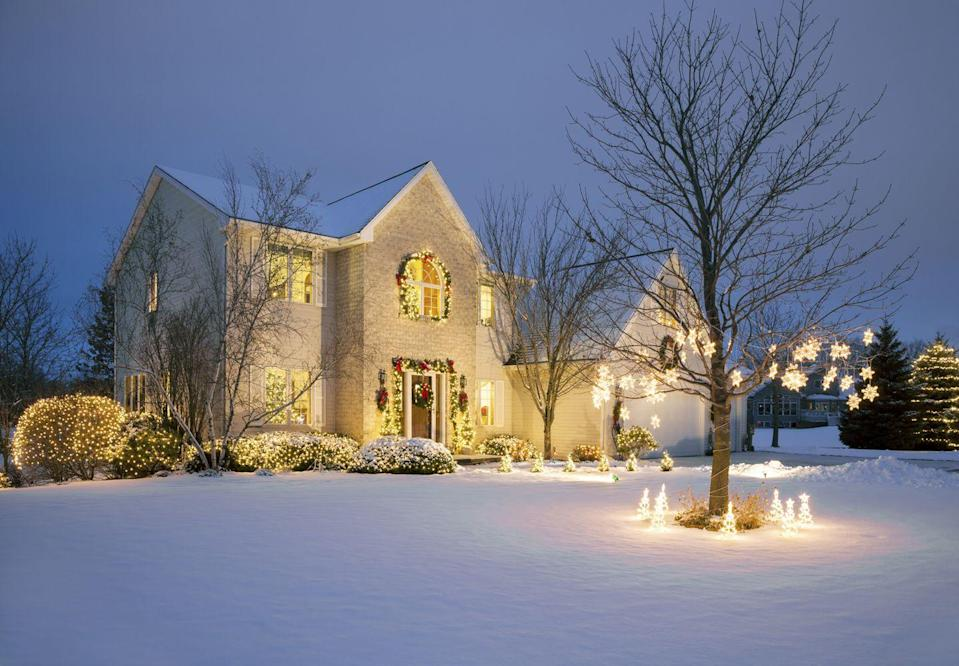 <p>There's nothing quite as classic as a palette of white set aglow with lights. Even if you don't see snow over the holidays, glowing exterior decor will add a beautiful ambiance to your yard. </p>