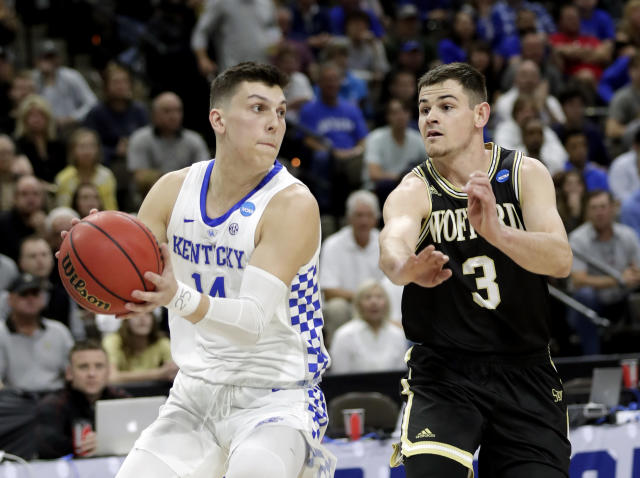Kentucky's Tyler Herro, left, looks to pass as he is guarded by Wofford's Fletcher Magee (3) during the first half of a second-round game in the NCAA mens college basketball tournament in Jacksonville, Fla., Saturday, March 23, 2019. (AP Photo/John Raoux)