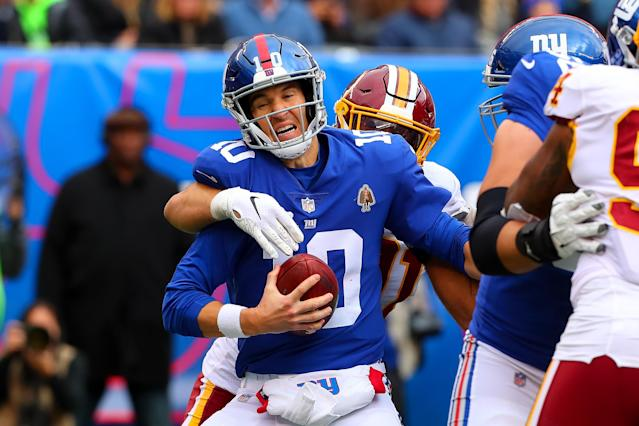 It was another rough day at the office for Eli Manning, who was sacked seven times on Sunday. (Getty Images)
