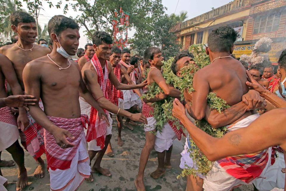 Gajan sanyasis with prickles on their body, dance as part of their rituals to get the blessings of the god through the pain on Dharamraj festival on the day of Baisakh Purnima at Goalpara in Birbhum district of West Bengal, Monday, 26 April 2021.