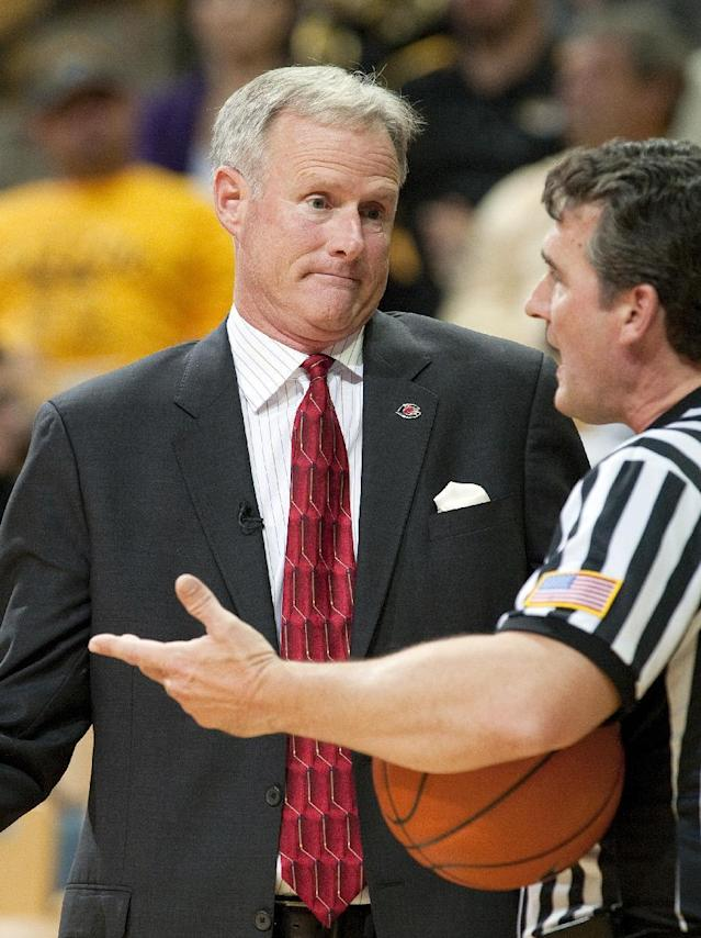 Central Missouri head coach Kim Anderson, left, argues a call with the referee during the second half of an NCAA college basketball exhibition game against Missouri, Friday, Nov. 1, 2013, in Columbia, Mo. Missouri won 92-79. (AP Photo/L.G. Patterson)