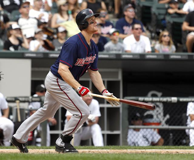 Minnesota Twins' Justin Morneau watches his grand slam off Chicago White Sox relief pitcher Nate Jones, scoring Joe Mauer, Pedro Florimon and Clete Thomas, during the seventh inning of a baseball game Friday, Aug. 9, 2013, in Chicago. (AP Photo/Charles Rex Arbogast)