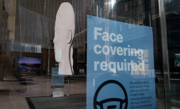 Businesses in New Brunswick can still require people to wear masks, even after the State of Emergency order is lifted at midnight on Friday.  (Evan Mitsui/CBC - image credit)