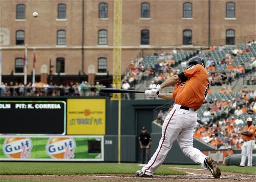 Baltimore Orioles' J.J. Hardy hits a solo home run in the third inning of a baseball game against the Kansas City Royals in Baltimore, Saturday, May 26, 2012. (AP Photo/Patrick Semansky)
