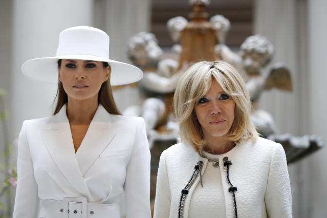 <p>First lady Melania Trump, left, and Brigitte Macron, wife of French President Emmanuel Macron, pause for a photograph together as they tour the National Gallery of Art, Tuesday April 24, 2018, in Washington. (Photo: Jacquelyn Martin/AP) </p>
