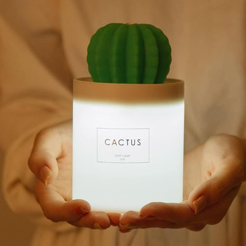 """<h3>Cool Mist Mini Cactus Humidifier</h3><br>This mini, cactus-shaped humidifier is just tiny enough to sit in the toe of a Christmas-morning stocking. <br><br><strong>AmuseNd</strong> Cool Mist Cactus Humidifier, $, available at <a href=""""https://amzn.to/2JE3jgZ"""" rel=""""nofollow noopener"""" target=""""_blank"""" data-ylk=""""slk:Amazon"""" class=""""link rapid-noclick-resp"""">Amazon</a>"""