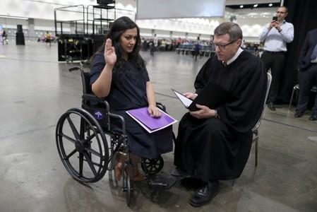 Judge hurries U.S. naturalization as pregnant woman gets contractions
