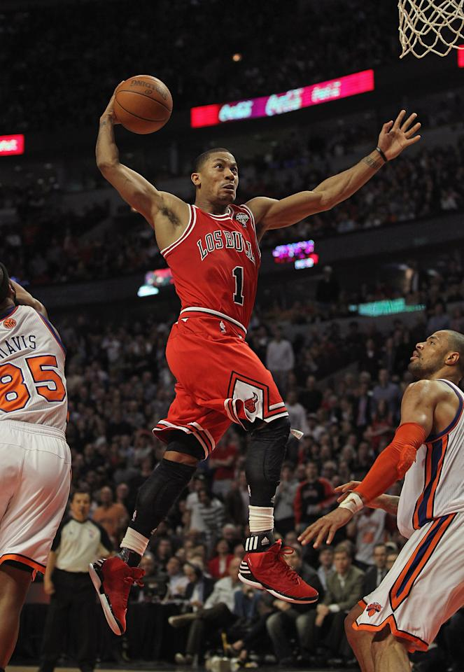 CHICAGO, IL - MARCH 12: Derrick Rose #1 of the Chicago Bulls goes up for a dunk between Baron Davis #85 and Tyson Chandler #6 of the New York Knicks on his way to a game-high 32 points at the United Center on March 12, 2012 in Chicago, Illinois. The Bulls defeated the Knicks 104-99. NOTE TO USER: User expressly acknowledges and agrees that, by downloading and or using this photograph, User is consenting to the terms and conditions of the Getty Images License Agreement. (Photo by Jonathan Daniel/Getty Images)