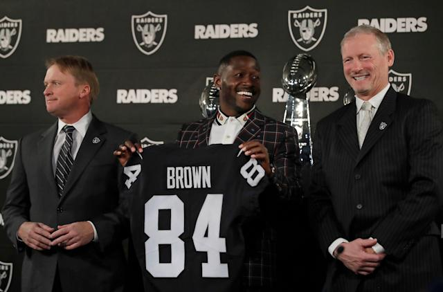 Flanked by Super Bowl trophies, Raiders brass did a victory lap with Antonio Brown Wednesday while introducing their new All-Pro receiver. (AP)