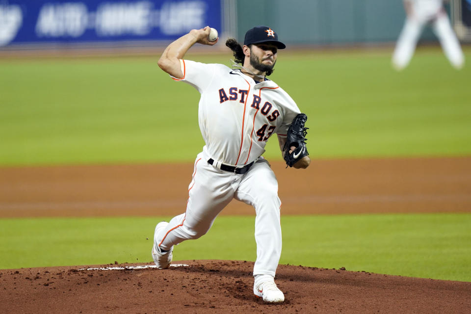 Houston Astros' Lance McCullers Jr. throws against the San Francisco Giants during the first inning of a baseball game Monday, Aug. 10, 2020, in Houston. (AP Photo/David J. Phillip)