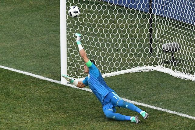 El Hadary, 45, made an incredible penalty save but was powerless to keep out a second spot-kick (AFP Photo/Mark RALSTON)