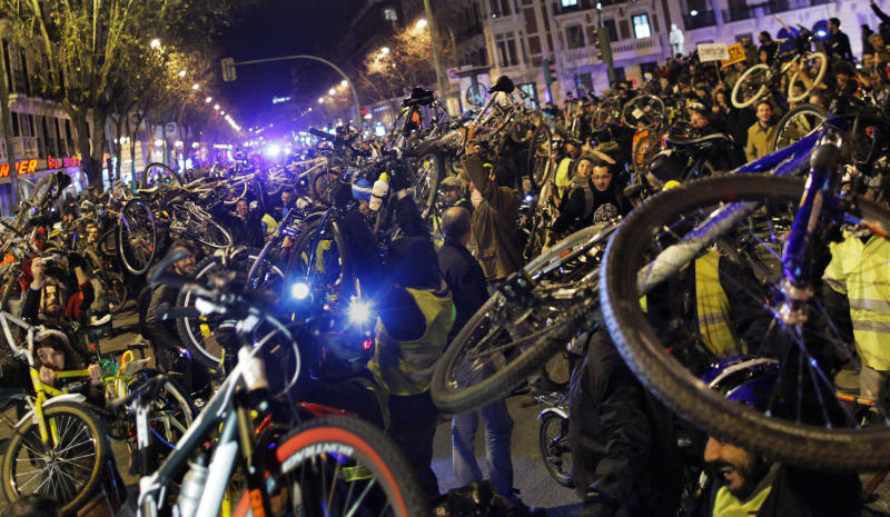 Protestors hold their bikes up during a demonstration against corruption, in Madrid, Spain, Thursday, Jan. 31, 2013. Spain's governing Popular Party was battling Thursday to defend its honor by denying fresh newspaper reports of regular under-the-table payments to leading members, including Prime Minister Mariano Rajoy. (AP Photo/Andres Kudacki)