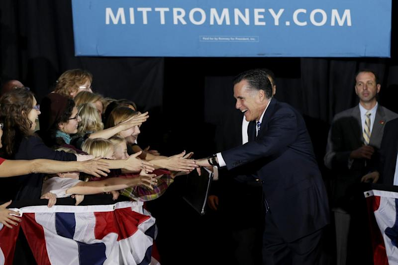 Republican presidential candidate, former Massachusetts Gov. Mitt Romney greets supporters as he campaigns at the Wisconsin Products Pavilion at State Fair Park in West Allis, Wis., Friday, Nov. 2, 2012. (AP Photo/Charles Dharapak)