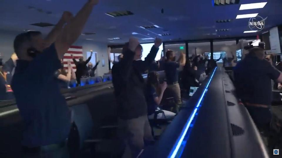 NASA crew celebrating the landing of rover Perseverance on Mars.