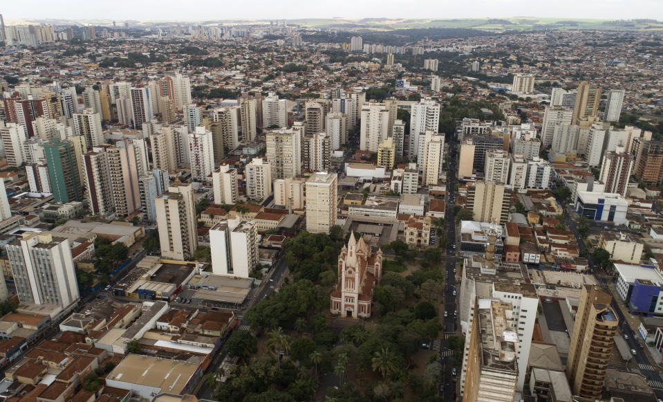 An aerial view of the Cathedral in downtown Ribeirao Preto, Sao Paulo state, Brazil, Friday, May 28, 2021. The city imposed strict shutdown measures this week to stop the spread of COVID-19, halting public transportation for the first time and closing supermarkets. (AP Photo/Andre Penner)