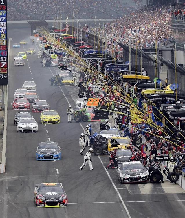 Jeff Gordon drives off pit road during the Brickyard 400 auto race Indianapolis Motor Speedway in Indianapolis, Sunday, July 27, 2014. (AP Photo/AJ Mast)