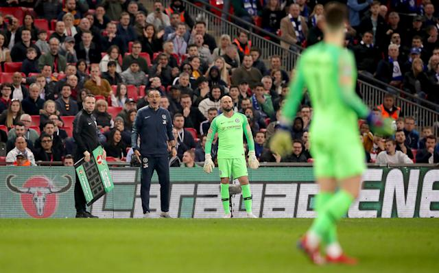 (Above) Chelsea manager Maurizio Sarri reacts with shock after goalkeeper Kepa Arrizabalaga waves off his substitution late in the League Cup final. (Below) Chelsea backup keeper Willy Caballero shrugs amid the confusion at Wembley Stadium. (Both images via Getty)