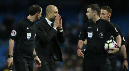 Manchester City v Liverpool - Premier League - Etihad Stadium - 19/3/17 Manchester City manager Pep Guardiola speaks with referee Michael Oliver after the game Reuters / Andrew Yates Livepic
