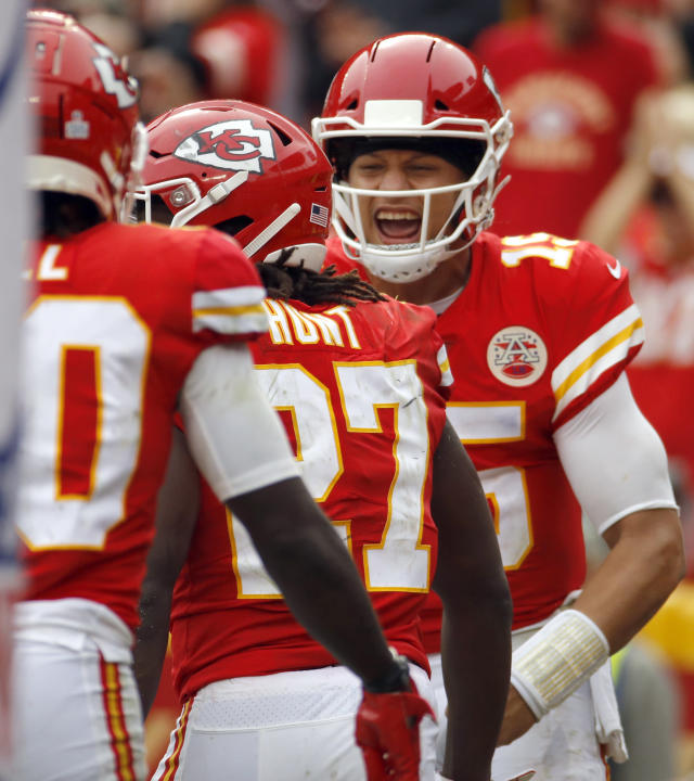 Kansas City Chiefs quarterback Patrick Mahomes (15) celebrates a touchdown by running back Kareem Hunt (27) during the second half of an NFL football game against the Jacksonville Jaguars in Kansas City, Mo., Sunday, Oct. 7, 2018. (AP Photo/Charlie Riedel)