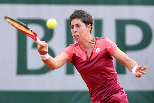 PARIS, FRANCE - JUNE 02: Carla Suarez Navarro of Spain plays a forehand in her Women's Singles match against Sara of Italy during day eight of the French Open at Roland Garros on June 2, 2013 in Paris, France. (Photo by Matthew Stockman/Getty Images)