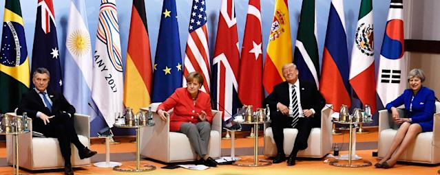"<p>From left: Argentina's President Mauricio Macri, German Chancellor Angela Merkel, President Donald Trump and Britain's Prime Minister Theresa May attend the ""retreat meeting"" on the first day of the G-20 summit in Hamburg, northern Germany, on Friday July 7, 2017. (Photo: John MacDougall/Pool Photo via AP) </p>"