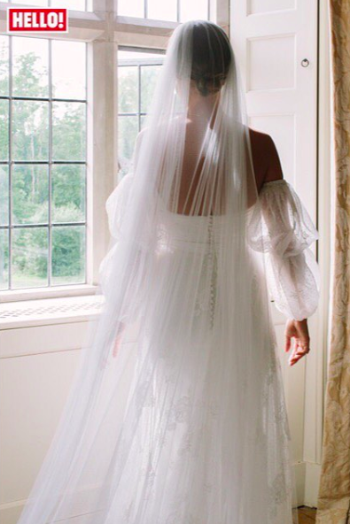 <p>The former 'Made In Chelsea' star wore a bespoke Halfpenny London dress for her wedding to Hugo Taylor. Made from French lace, spotty tulle and silk organza, the gown boasted double bubble sleeves and a long, plain veil. <em>[Photo: Instagram via Hello! magazine]</em> </p>