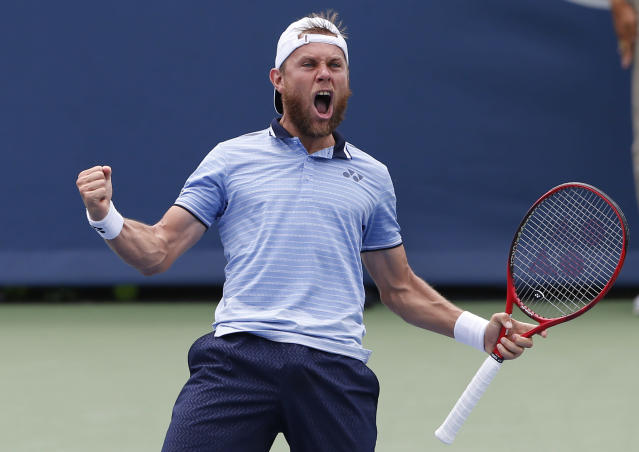 Radu Albot, of Moldova, reacts to winning his match against Marin Cilic, of Croatia, during first round play at the Western & Southern Open tennis tournament, Monday, Aug. 12, 2019, in Mason, Ohio. (AP Photo/Gary Landers)
