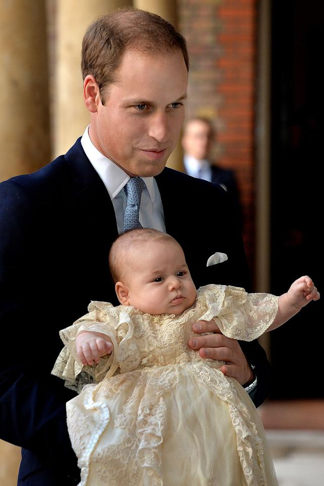 """<p>Three months after his birth, Prince George arrived at Chapel Royal in St. Jame's Palace for his royal christening. <a href=""""https://www.marieclaire.com/celebrity/g21729500/prince-william-transformation-photos/"""" target=""""_blank"""">Prince William</a> held the little prince, who was decked out in the historic Honiton lace christening robe (which Princess Charlotte wore two years later, and Prince Louis is rumored to wear this year).</p>"""