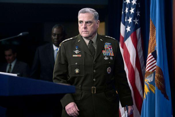 PHOTO: Joint Chiefs Chairman Gen. Mark Milley, right, is followed by Defense Secretary Lloyd Austin as they take the stage for a press briefing at the Pentagon, July 21, 2021, in Washington, D.C. (Kevin Wolf/AP)