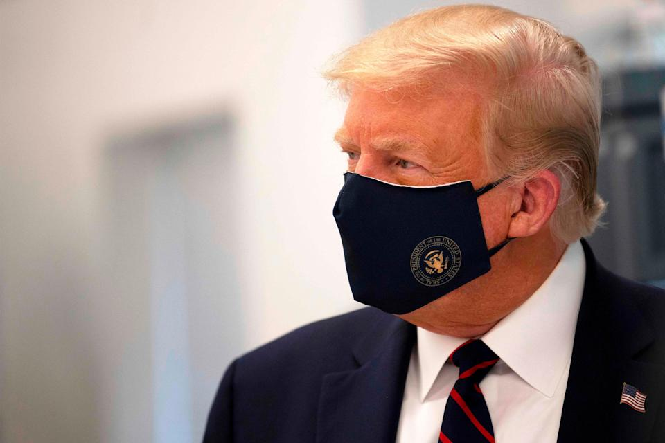 <p>Donald Trump held out for months before wearing a mask in public</p> (AFP via Getty Images)