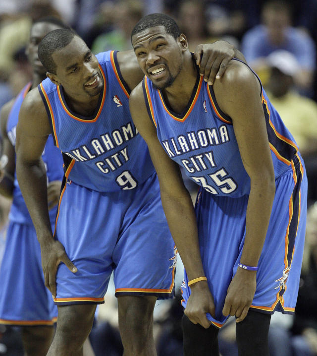Oklahoma City Thunder power forward Serge Ibaka (9) and Oklahoma City Thunder small forward Kevin Durant (35) react to the closing moments during a timeout near the end Game 3 in a Western Conference semifinal NBA basketball playoff series against the Memphis Grizzlies in Memphis, Tenn., Saturday, May 11, 2013. The Grizzlies defeated the Thunder 87-81. (AP Photo/Danny Johnston)