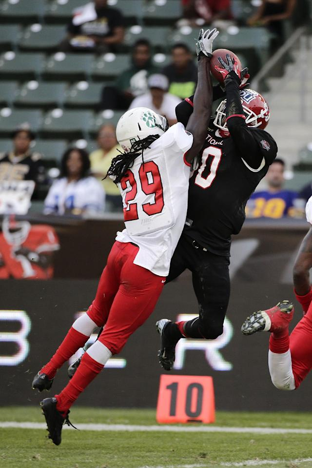 National team wide receiver Isaiah Burse, right, of Fresno State, makes a catch against American team defensive back Brian Dixon, of Northwest Missouri State, during the first half of the NFLPA Collegiate Bowl football game on Saturday, Jan. 18, 2014, in Carson, Calif. (AP Photo/Jae C. Hong)