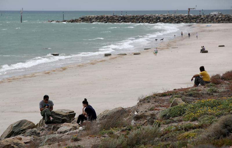Family and Friends wait as Police and SES search the beach at Glenelg North for a man who drowned in Adelaide in December. Source: AAP