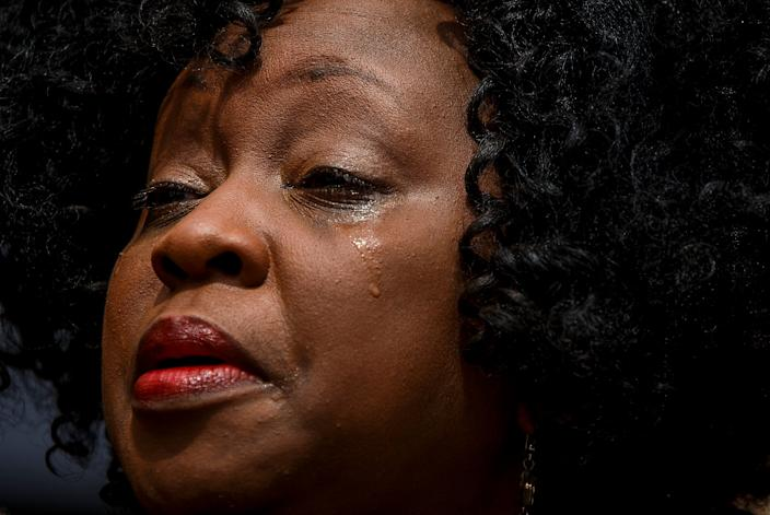 Renee Gathers is overcome with emotions during a vigil to honor the victims of the mass shooting on June 1, 2019 in Virginia Beach, Va. (Photo: Kristen Zeis/The Virginian-Pilot via AP)