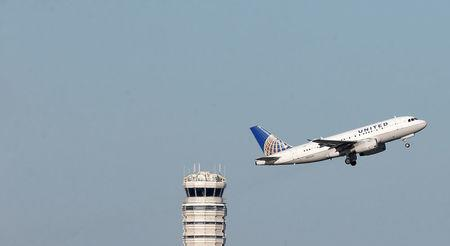 FILE PHOTO: A United Airlines jet takes off from Washington National Airport in Washington