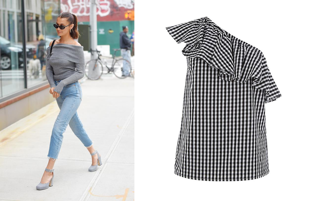 """<p>Bella Hadid also became the unwitting poster girl for the <a rel=""""nofollow"""" href=""""https://www.johnlewis.com/warehouse-gingham-one-shoulder-top-black-white/p3183987#media-overlay_show"""">gingham</a> trend this summer, sporting a pair of shorts in April and clunky Zara platforms in May.<br /><i>[Photo: Getty/John Lewis]</i> </p>"""