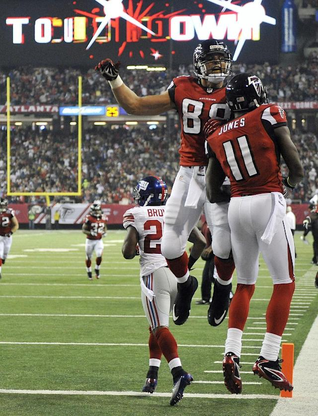 Atlanta Falcons tight end Tony Gonzalez (88) celebrates with wide receiver Julio Jones (11) after Jones scored a touchdown during the second half of an NFL football game against the New York Giants, Sunday, Dec. 16, 2012, in Atlanta. (AP Photo/Rich Addicks)