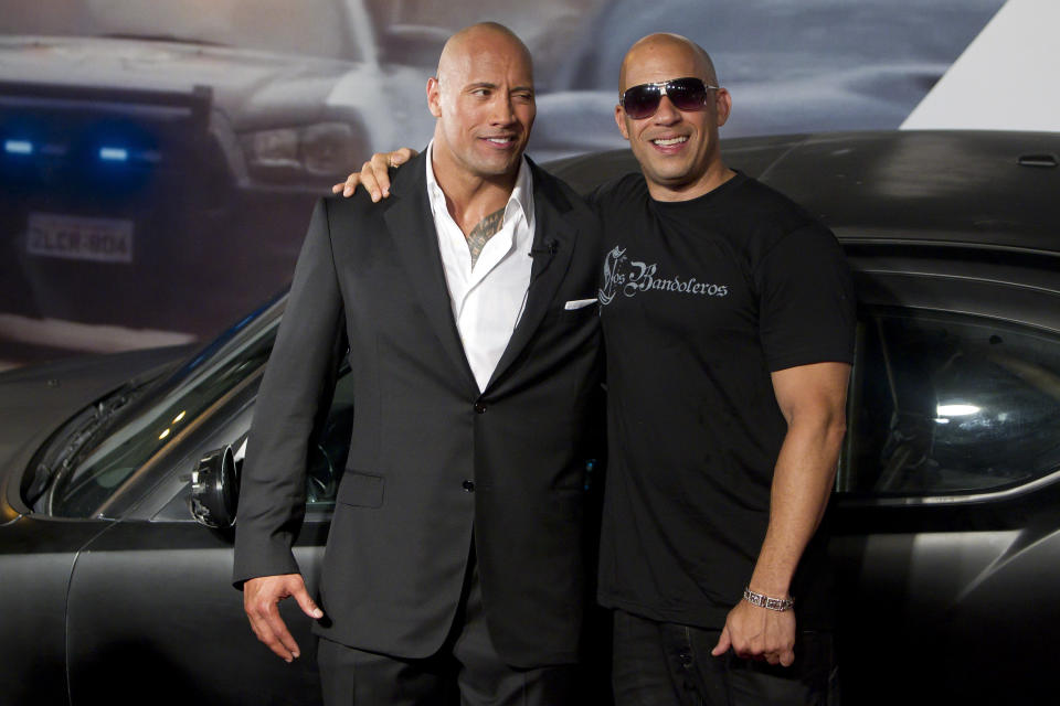 RIO DE JANEIRO, BRAZIL - APRIL 15:   Dwayne Johnson (The Rock) and Vin Diesel (R) pose for photographers during the premiere of the movie