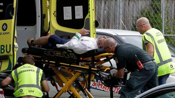 PHOTO: Ambulance staff take a man from outside a mosque in central Christchurch, New Zealand, Friday, March 15, 2019. A witness says many people have been killed in a mass shooting at a mosque in the New Zealand city of Christchurch. (AP)