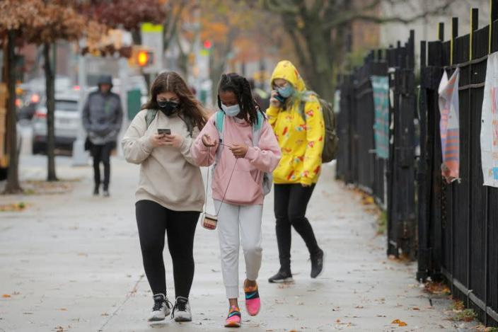 FILE PHOTO: Students exit a school as the spread of coronavirus disease (COVID-19) continues, in Brooklyn, New York