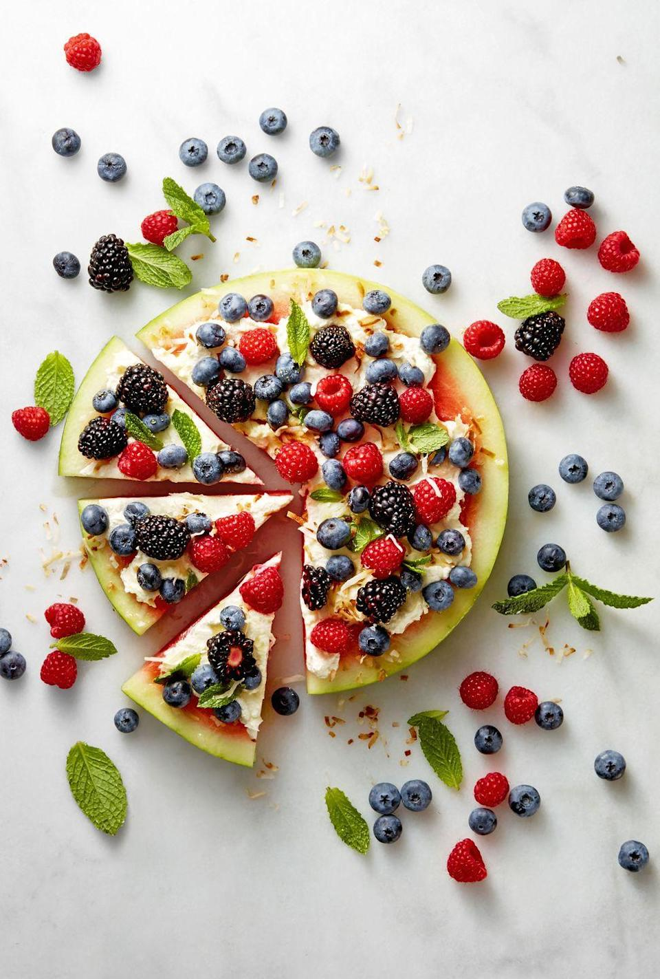 """<p>This patriotic """"pie"""" is delicious any way you slice it. </p><p><a href=""""https://www.goodhousekeeping.com/food-recipes/a39347/watermelon-pizza-recipe/"""" rel=""""nofollow noopener"""" target=""""_blank"""" data-ylk=""""slk:Get the recipe for Watermelon Pizza »"""" class=""""link rapid-noclick-resp""""><em>Get the recipe for Watermelon Pizza » </em></a><br></p>"""